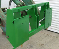Adapter Plate Mounts on John Deere 48 And 58 Series Tractor Loaders, Allows Attachment Of Skid Steer Attachments