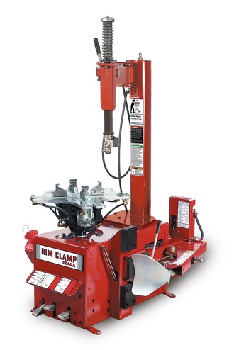 Coats Model 5040 Rim Clamp Tire Changer Available In Either Air Or Electric Turntable Drive